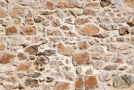 stone wall of a building in the countryside of Tuscany