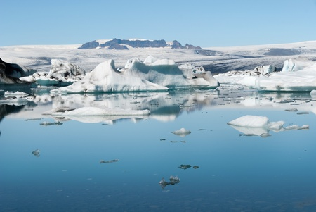 glacier reflected on the Jokulsarlon lake in Iceland photo