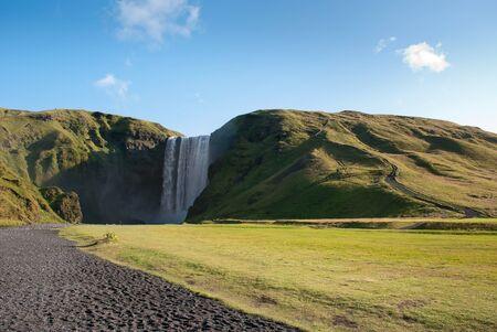 skogafoss waterfall: Skogafoss  waterfall at sunrise in Iceland  Stock Photo