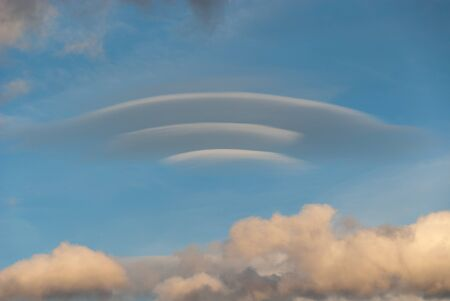 lenticular cloud: lenticular cloud at sunset in Italy Stock Photo