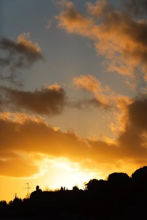 genoa: orange sunset with clouds in Genoa