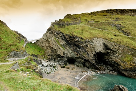 arcane: Ruins of the castle of Camelot and Merlin s Cave at Tintagel in Cornwall