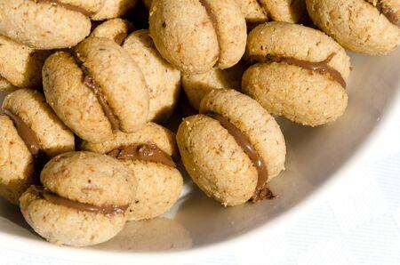 Baci di Dama and chocolate with hazelnuts Stock Photo - 13683122
