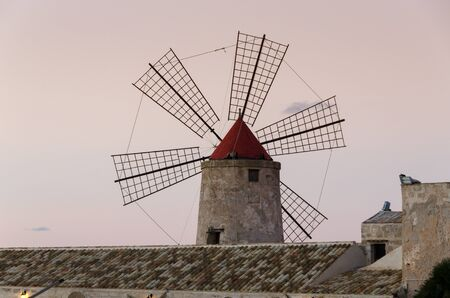 trapani: windmill at the salt pans of Trapani in Sicily