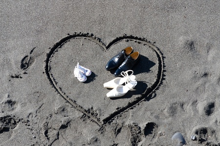 heart drawn in the sand on the beach of Camogli photo