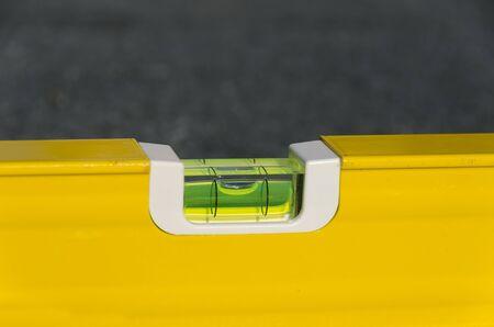 spirit level: Yellow spirit level on a roof