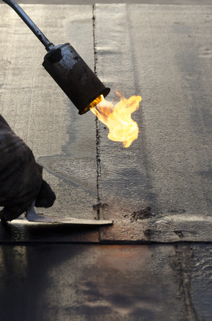 During welding flame of a waterproofing membrane on a roof