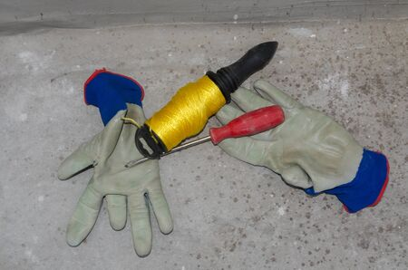 work gloves and tools on a construction site