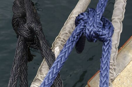 cleat: cleat with colored ropes for mooring of vessels