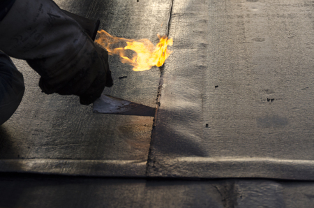 concrete construction: During welding flame of a waterproofing membrane on a roof