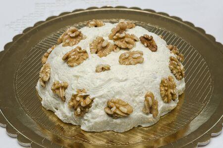 gorgonzola: cake of gorgonzola cheese with walnuts
