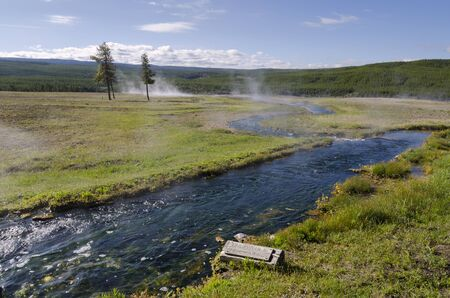 river and geysers in Yellowstone National Park