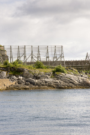 stockfish: Overview of racks for drying stockfish at Lofoten in Norway Stock Photo