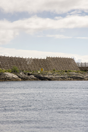 Overview of racks for drying stockfish at Lofoten in Norway Stock Photo