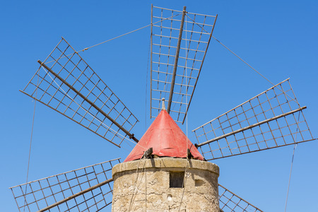 windmills at the saltworks of Trapani in Sicily in Italy