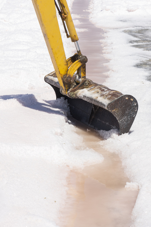 scraper at work at saltworks of Trapani in Sicily in Italy