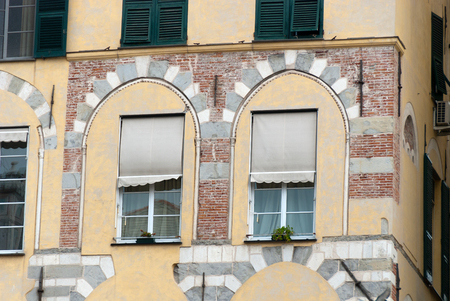 windows in an ancient building of the city of Genoa in Italy