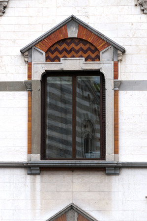 decorated windows in an ancient building of the city of Genoa in Italy