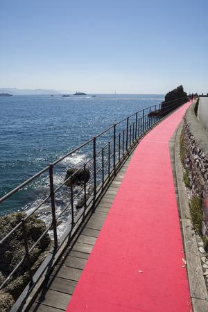 red carpet on the sea along the coast of Portofino in Genoa in Italy