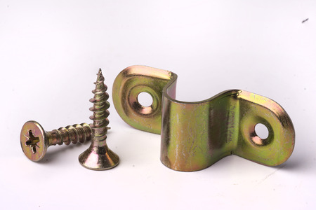 tornillos: tornillos y gancho de metal Foto de archivo