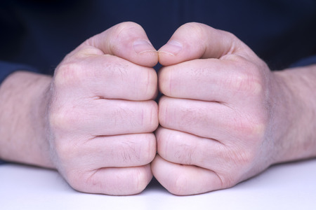 approached: fists approached Stock Photo