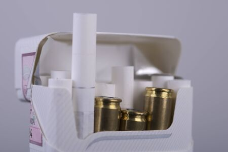 cigarette pack: bullets in the cigarette pack