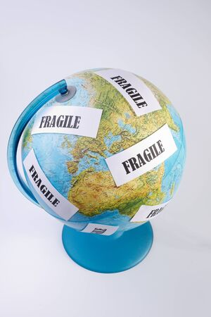 safeguarding: globe written with fragile Stock Photo