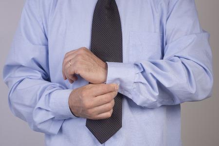 cuff: Man buttoning shirt cuff