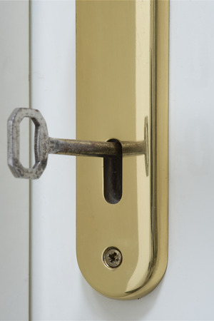 lock and key: key in the lock Stock Photo