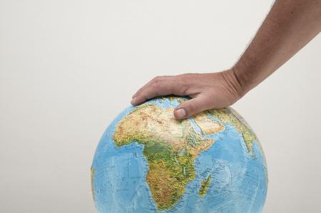 oppress: Hand pressing world Stock Photo
