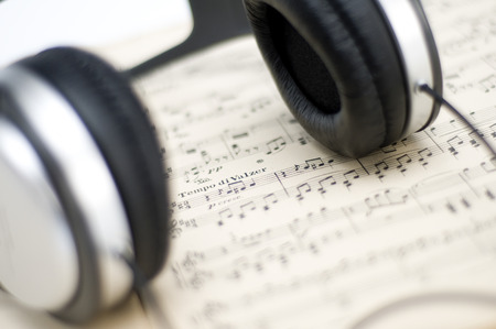 musical score: musical score and headphones Stock Photo