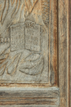 particularly: particularly of a bas-relief carved in wood