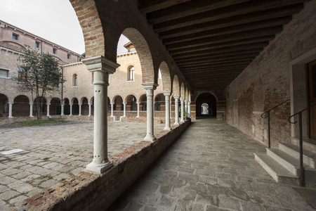view of an atrium in a building: cloister of the former convent of SS. Cosmas and Damian in the island of Giudecca in Venice Stock Photo