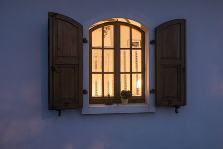 evening: window with the light on in the evening