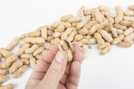 peeling peanuts on the table