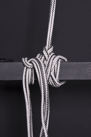 knotted rope: Knotted rope on a beam Stock Photo
