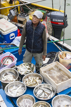 A fisherman sell the fish directly from the boat in Tai O, Hong Kong