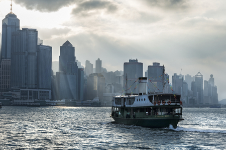 A star ferry on Victoria harbor in Hong Kong