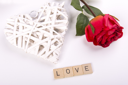furnishings: woven white heart, red rose with the word Love