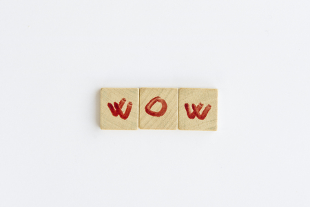 letterpress words: Wow word formed with the letters written on pieces of wood square