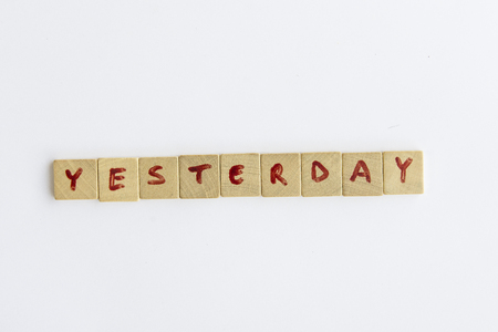 letterpress type: Yesterday word formed with the letters written on pieces of wood square Stock Photo