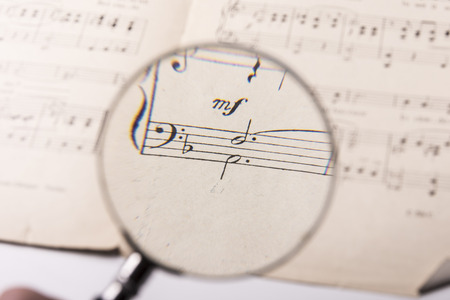 View through a magnifying glass of notes in a music score