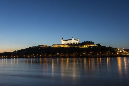 A panoramic view of the Danube river and the city in Bratislava by night Editorial