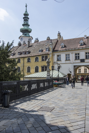 bratislava: People walk on the street in the downtown with a view of Michaels Gate on the background Editorial