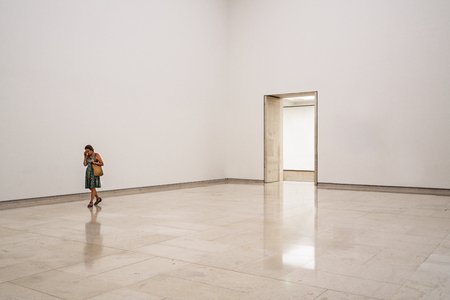 leopold: A woman is walking in an empty room at the Leopold Museum