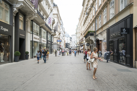 articles: People walk for shopping in Kohlmarkt street in Vienna Editorial