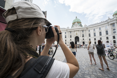 Tourist do a photo in the courtyard of the Hofburg castle in Vienna Editorial