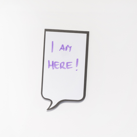 i pad: a white memo pad with the shape of a comic with the inscription I am here
