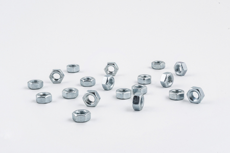 bolts and nuts: some nuts on a white background