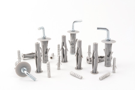 metal fastener: a series of metal clips with plastic plugs on a white background